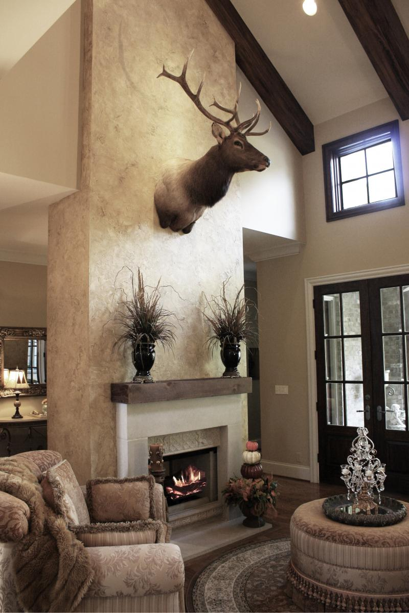 Custom color painted walls plaster feature wall and faux wood beams